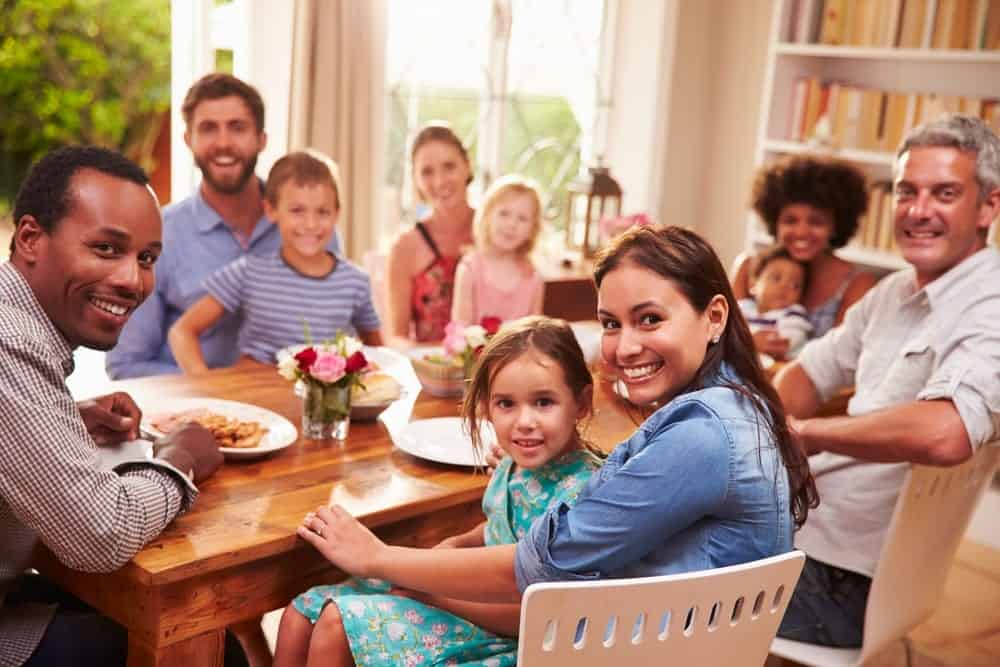family sitting down to dinner together